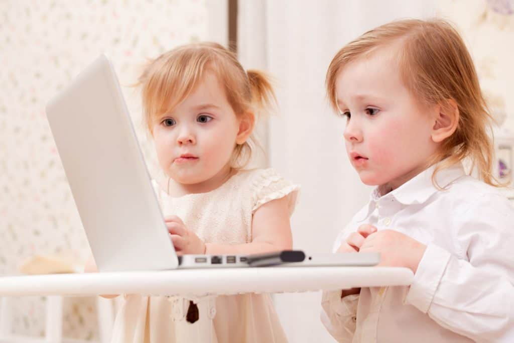 kids looking at a laptop